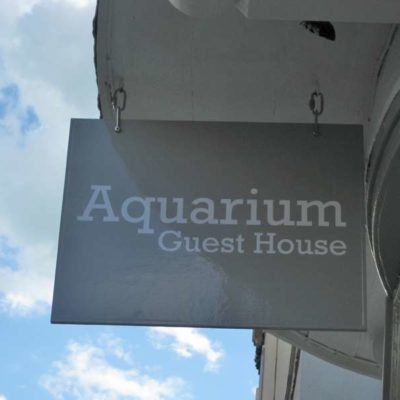 Aquarium Guest House Sign